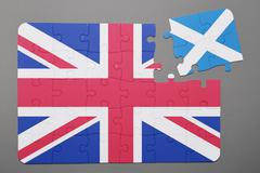 Puzzle with national flag of great britain and scotland piece detached. - stock photo