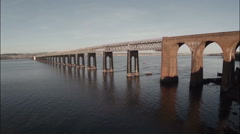 Cinematic aerial shot of the Tay bridge in Dundee during sunrise Stock Footage