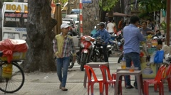 HO CHI MINH / SAIGON, VIETNAM - 2015: Slow motion Vietnamese people streets Stock Footage