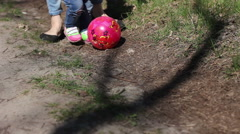 Woman and girl play with ball in park Stock Footage