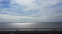 POV-passenger window driving causeway to Galveston sun light on water - stock footage