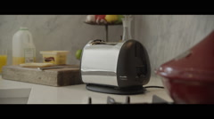 Toaster popping fresh hot toast up - stock footage