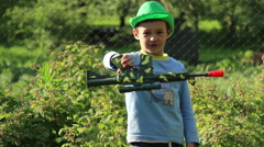 boy turns a toy gun in his hand - stock footage
