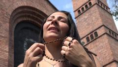 Praying Woman with Rosary Beads Stock Footage