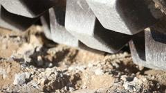 Closeup of steam roller wheel on gravel Stock Footage