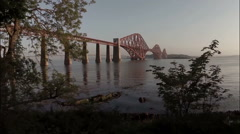 Stock Video Footage of Aerial shot revealing the Forth Rail Bridge outside Edinburgh