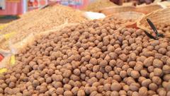 Walnut on market 2 Stock Footage