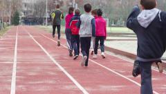 Children's sports training group of schoolchildren running lifting their feet - stock footage