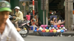 HO CHI MINH / SAIGON, VIETNAM - 2015: selling goods on street Stock Footage