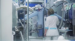 Steaming a shirt with a press at laundry Stock Footage