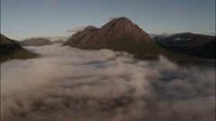 Aerial shot through cloud inversion revealing buachaille etive mor Stock Footage