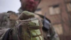 Loading airsoft plastic balls to an assault rifle magazine Stock Footage