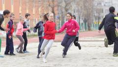 Stock Video Footage of Sports club for children - kids with coach play in active running games slow