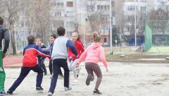 Sports club for children - kids with coach play in active running games slow - stock footage