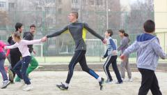 Stock Video Footage of Sports club for children - kids with coach play in active running games