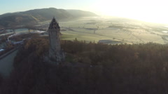 Aerial shot of the Wallace Monument in Scotland Stock Footage