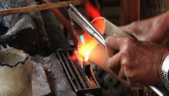 Man melts silver in crucible with the gas burned in Surin, Thailand. Stock Footage