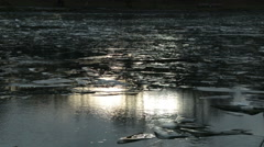 Ice and a pond with a solar flare - stock footage