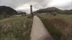 Aerial shot of the Glenfinnan Monument in the Scottish Highlands Stock Footage