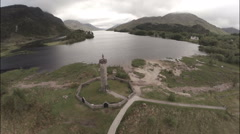 Aerial shot of the Glenfinnan Monument in the Scottish Highlands - stock footage