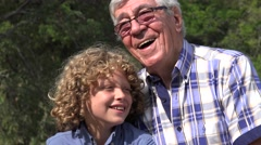 Grandfather and Grandson Outdoors Stock Footage