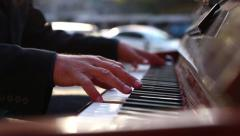 Old Man Playing the Piano in the City Stock Footage