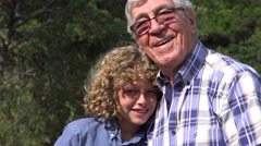 Grandfather and Grandson Being Silly Stock Footage