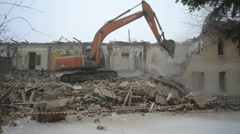 Excavator breaks house. Tyumen. Russia Stock Footage