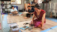Women produce traditional local silver jewellery in Surin, Thailand. Stock Footage