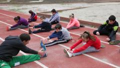 Sports club for children - open air activities, warm-up, jogging run, stretching Stock Footage