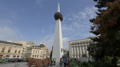 A group of tourists walking by the Monument of Rebirth in  Bucharest Stock Footage
