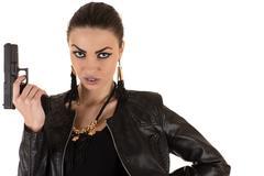 dangerous woman in bodysuit with gun in hand - stock photo