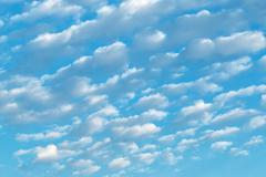 White cumulus clouds Stock Photos