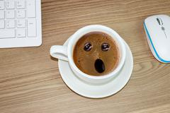 coffee cup with astonished expression in  in cream coffee - stock photo