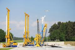 Construction site with drilling rigs - stock photo