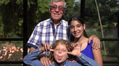 Grandfather and Grandchildren Acting Silly Stock Footage