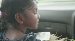 Adorable Indian Girl sitting in the Car - stock footage