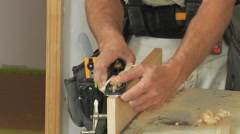Carpenter's hands and shavings - stock footage