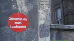 Red sign on an old building in Bucharest Stock Footage