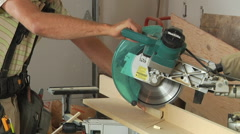 Carpenter's hands and Single Arm Multi-disc Stone Sawing Machine Stock Footage