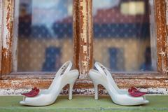 Bridal shoes on window parapet - stock photo