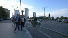 People and cars passing through Victory Square in Bucharest Stock Footage