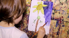 little girl painting at paper with watercolor - stock footage