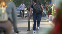 Riding bikes and roller skating on a street in Bucharest Stock Footage
