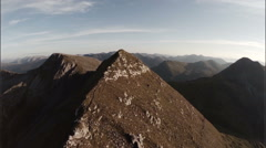 Spectacular aerial shot on Sgurr a'Mhaim mountain revealing devils ridge Stock Footage