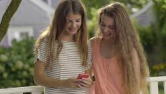 Teen Girls Look At Something On Smart Phone Stock Footage