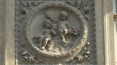 Bas-relief with two children on a wall in Bucharest Stock Footage