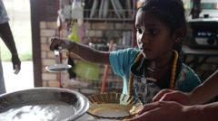 Young Adorable Indian Girl helping with cooking Stock Footage