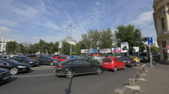 Traffic in Revolution Square in Bucharest Stock Footage