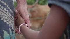 Young Adopted Happy Indian Girl holding hands with her mother Stock Footage